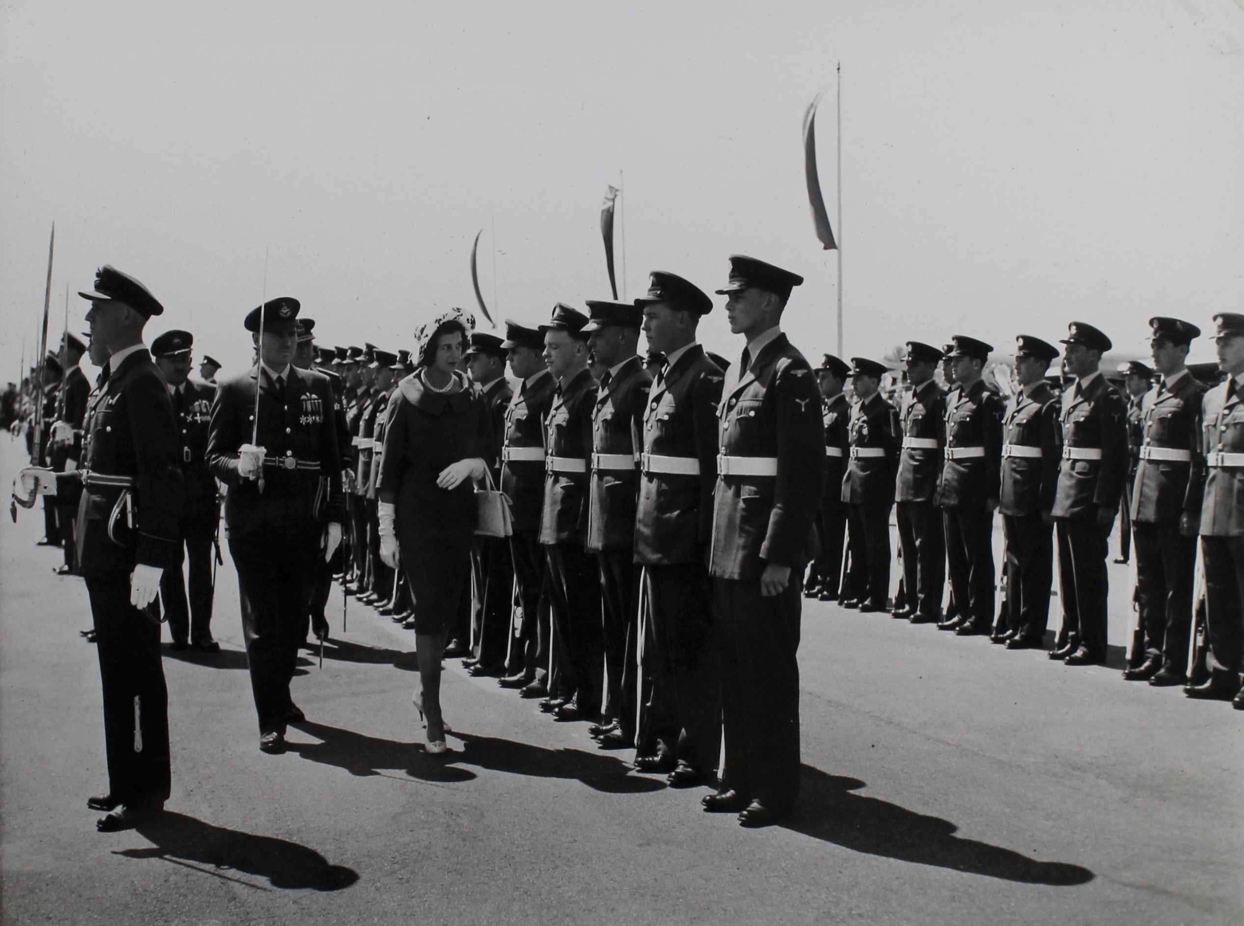 This image has an empty alt attribute; its file name is Personnel-at-presentation-of-squadron-standard-Courtesy-of-Marham-Aviation-Heritage-Centre.jpg